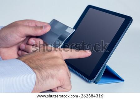 Man using tablet for online shopping in close up - stock photo