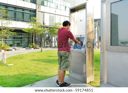 man using touch screen outdoor - stock photo