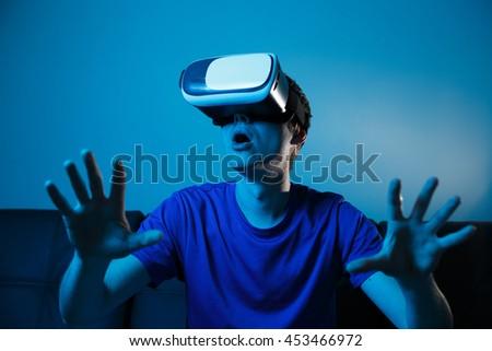 Man using VR glasses - stock photo