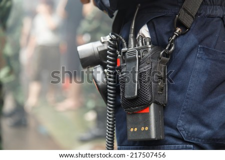 Man using walkie talkie - stock photo