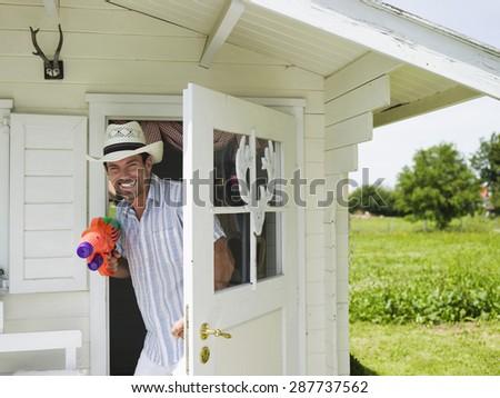Man using water gun - stock photo