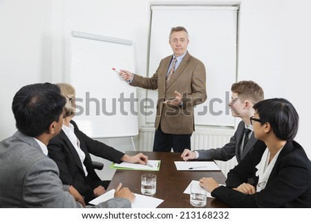 Man using whiteboard in business meeting