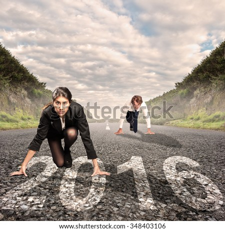 man versus woman on a road with year 2016 painted on it - stock photo