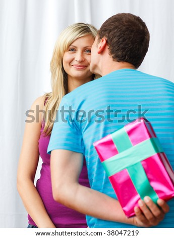 Man wait one kiss from his girlfriend before he gives her a present