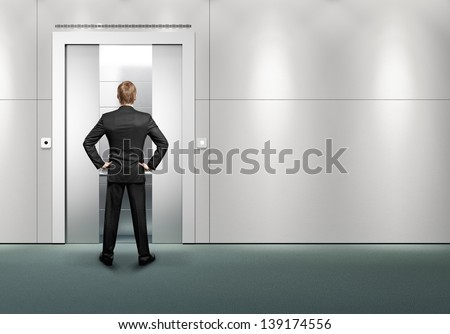 man waitinf for the lift - stock photo
