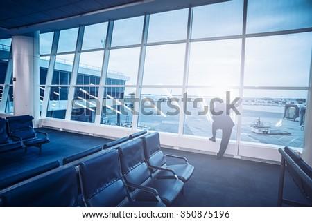 Man waiting at airport - stock photo
