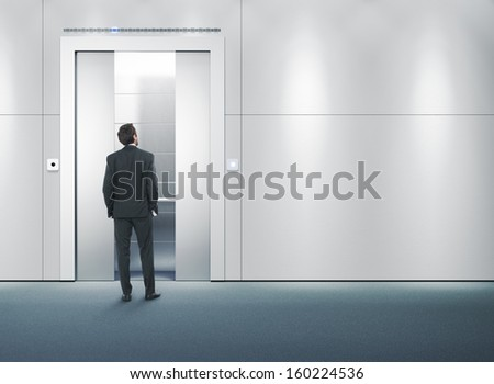 man waiting for a lift - stock photo