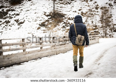 man walking alone in the wilds