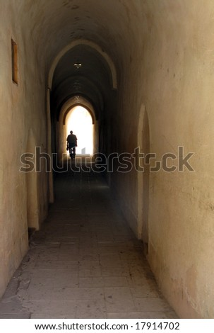 Man walking at the end of a tunnel - stock photo