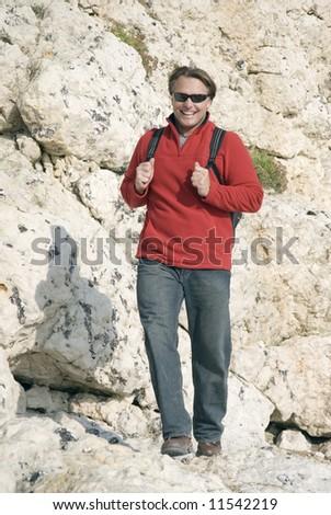 Man walking in mountains. - stock photo