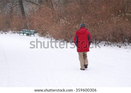 man walking in snow - stock photo