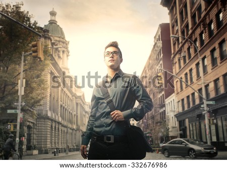 Man walking in the city - stock photo