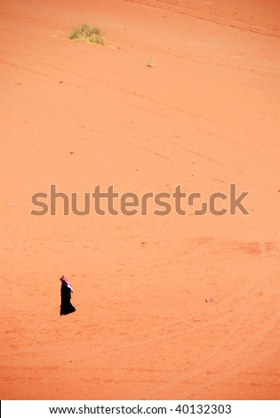 Man walking in the Desert of  Wadi Rum in Jordan - stock photo