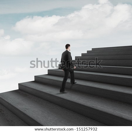 man walking near ladder in sky - stock photo