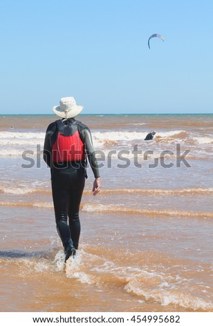 Man walking on a beach in Sidmouth, Devon - stock photo