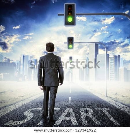 Man walking on street with traffic lights - stock photo