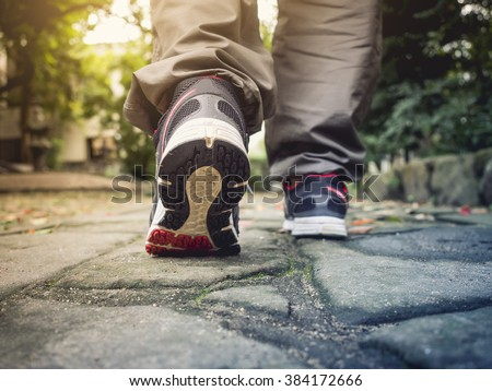 Man Walking on trail Outdoor Jogging exercise Healthy lifestyle - stock photo