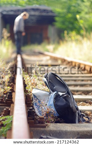 Man walking or standing on railway track and think about  suicide.  - stock photo