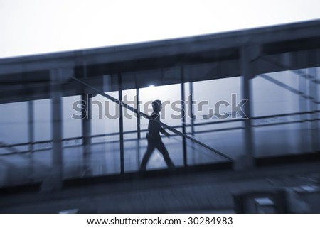 man walking though the channels at the pudong airport. - stock photo