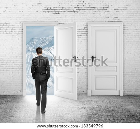 man walking to opened loft door - stock photo