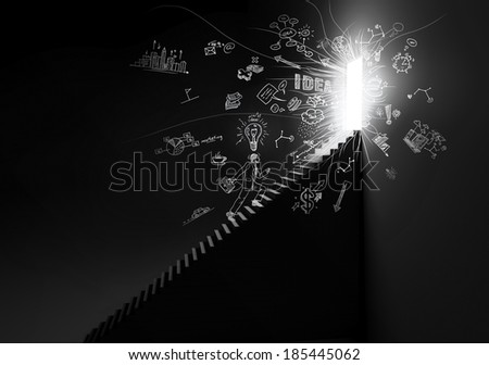 Man walking up the stairs to open doors - stock photo