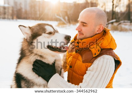 Man walking with dog winter  - stock photo