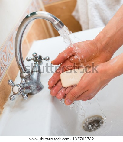 man washing his hands - stock photo