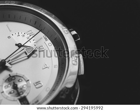 Man watches  detail, closeup, dark background