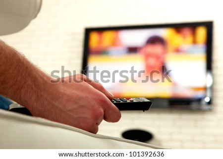 man watching tv - stock photo
