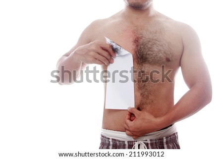 man waxing his chest to depilate hair isolated on white background with clipping path - stock photo