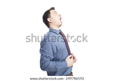 Man wearing a blue shirt and red tie. He is looking surprised. Over white background - stock photo