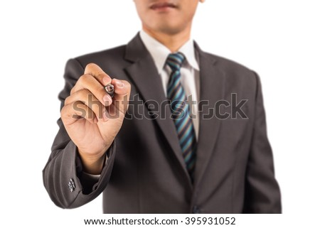 Man wearing a business suit pretending to write something on the air. - stock photo