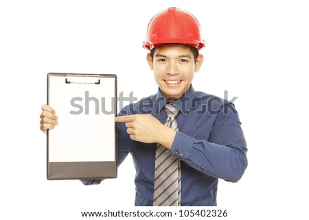 Man wearing a hard hat pointing at an empty clipboard - stock photo