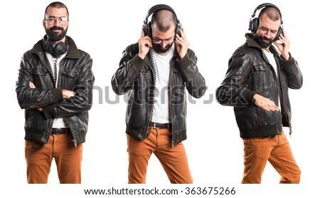 Man wearing a leather jacket listening music - stock photo