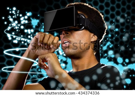 Man wearing a Virtual Reality headset and watching light paintings.  The image depicts technology and the entertainment industry. - stock photo