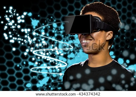 Man wearing a Virtual Reality headset and watching light paintings.  The image depicts technology and the entertainment industry.