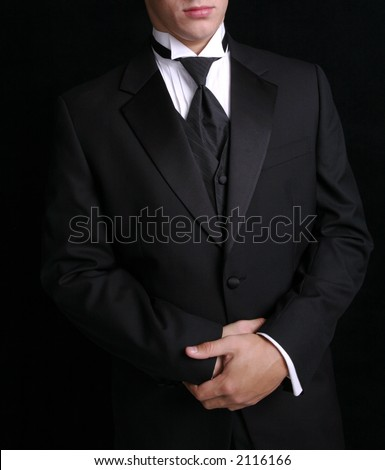 Man wearing black tuxedo, dress for special occassion. - stock photo