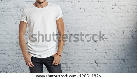 man wearing blank white t-shirt - stock photo