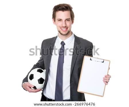 Man wearing business suit and holding soccer ball - stock photo