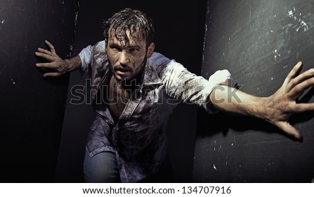 Man wearing dirty clothes - stock photo