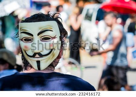 Man wearing Guy Fawkes mask during the 2014 G20 Economic Summit in Brisbane, Australia - stock photo