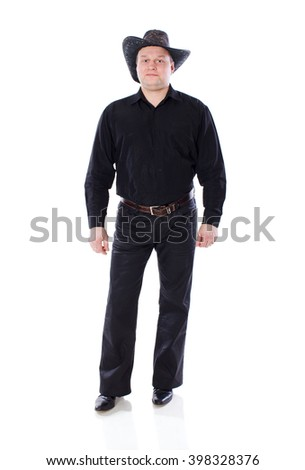 man wearing hat of cowboy standing isolated on white