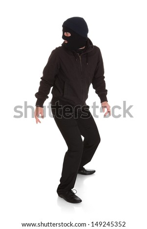 Man Wearing Mask Looking Back Over White Background - stock photo
