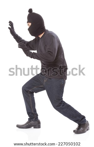Man wearing mask on over white background - stock photo