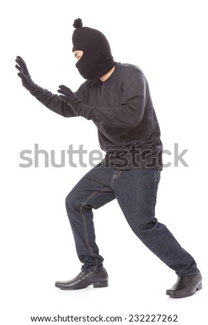 Man wearing mask on over white background