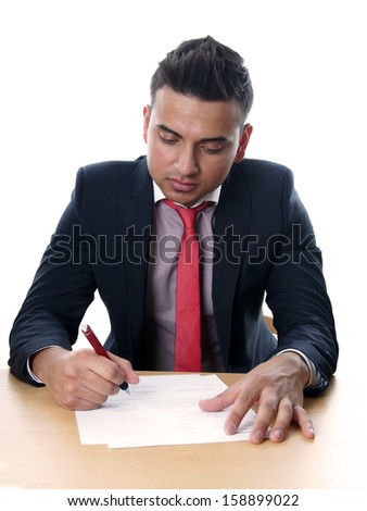 man wearing suit and tie signing contract  - stock photo