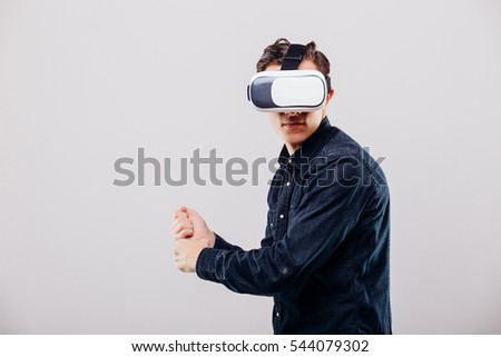 Man wearing virtual reality using a VR headset on white background