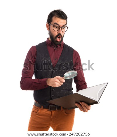 Man wearing waistcoat with magnifying glass  - stock photo