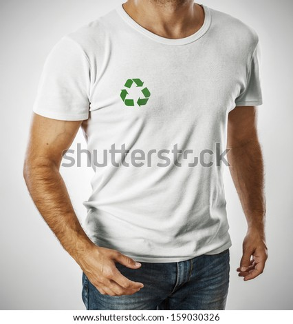 Man wearing white t-shirt with recycle symbol - stock photo
