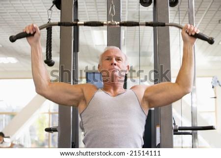 Man Weight Training At Gym - stock photo